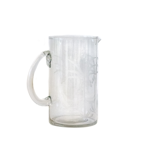 Glass pitcher with palm tree cut