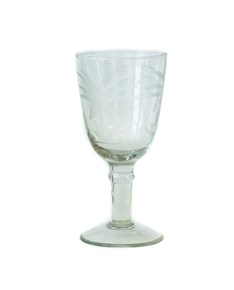 Wineglass with palm tree cut